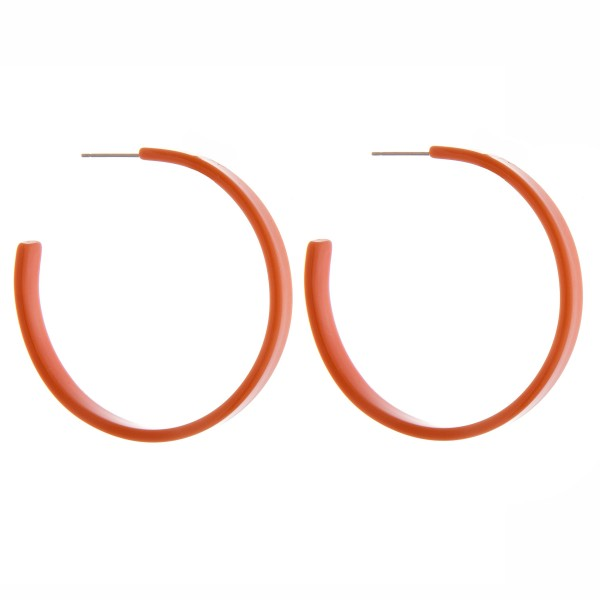"Resin colored hoop earrings.  - Approximately 2"" in diameter and 5mm in width"