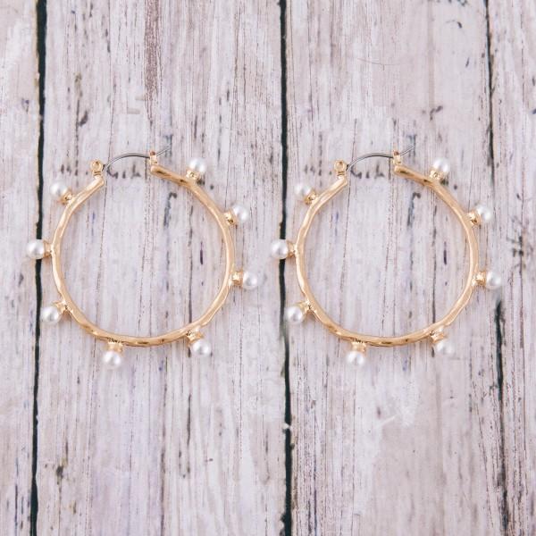 "Hammered pearl beaded pin catch hoop earrings.  - Approximately 1.5"" in diameter"