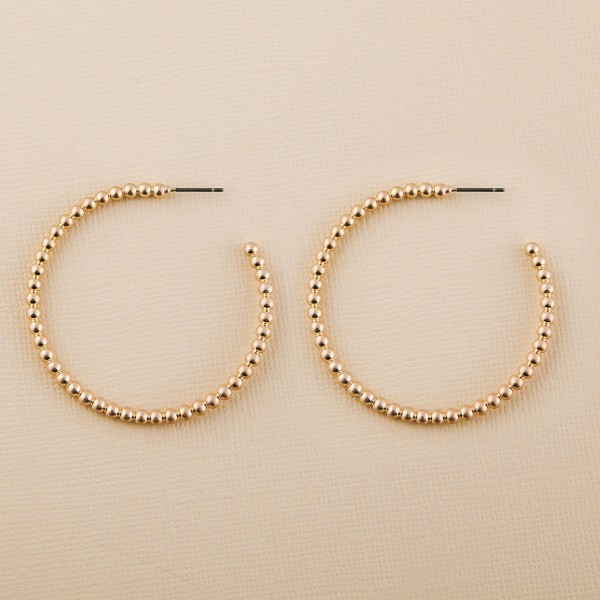 "Worn Gold Metal Ball Beaded Hoop Earrings.  - Approximately 1.75"" in diameter"