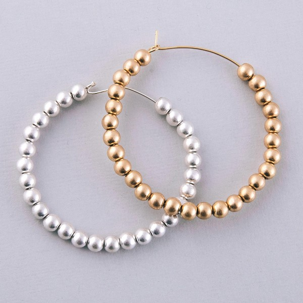 "Worn Gold sphere beaded wire hook hoop earrings.  - Approximately 2"" in diameter"