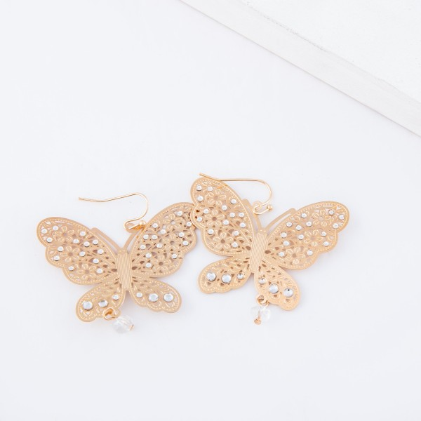 "Gold filigree butterfly drop earrings with beaded accents.  - Approximately 2"" x 2"""