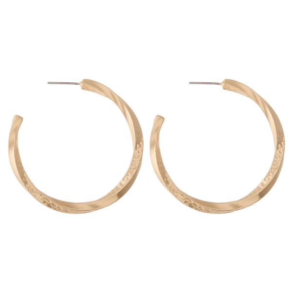 """Metal hoop earrings with swirl design and hammered accents.  - Approximately 1.5"""" L"""