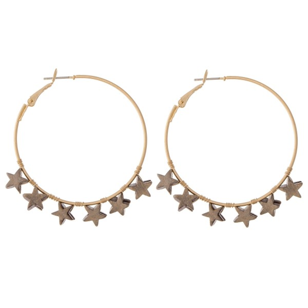 """Gold hoop earrings featuring wooden star accents. - Approximately 1"""" in diameter"""
