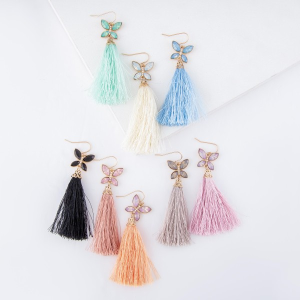 "Tassel earrings featuring a jeweled butterfly accent.  - Approximately 3"" L"