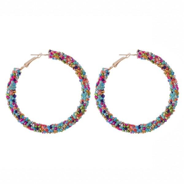 """Seed beaded statement hoop earrings.  - Approximately 2.5"""" in diameter"""
