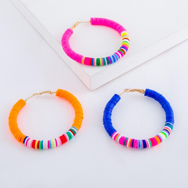 "Polymer Clay spacer disc beaded statement hoop earrings with multicolor details.  - Approximately 2"" in diameter"