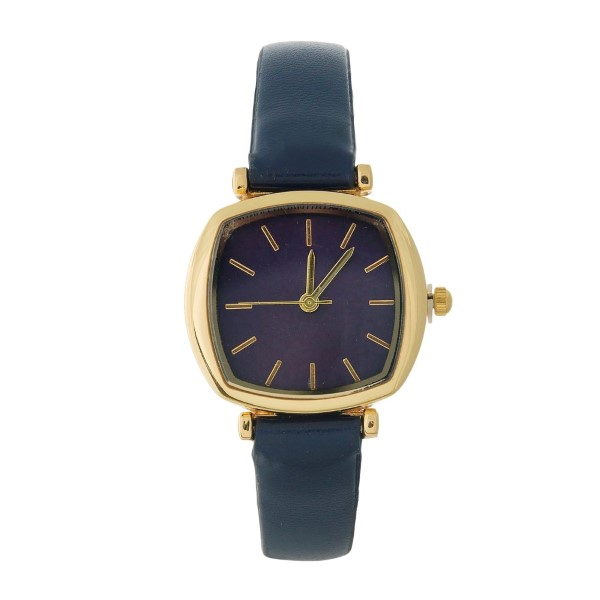 Dainty, faux leather watch with a square and monochromatic face.