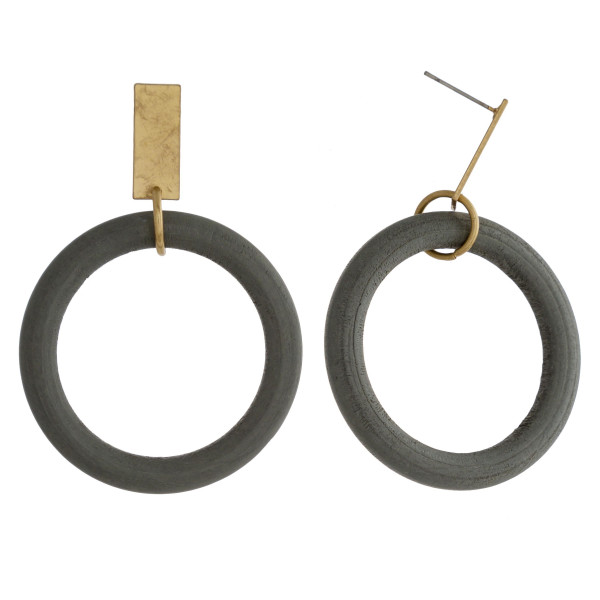 "Circular wood earrings featuring a gold metal stud accent. Approximately 2"" in length."