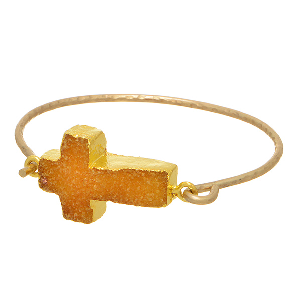 Matte gold tone bangle bracelet featuring a citrine druzy quartz geode horizontal east-west cross with a front latch closure.