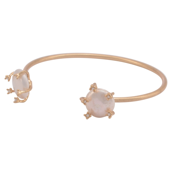 Worn gold tone cuff bracelet featuring two faux pearls with opal rhinestone accents.
