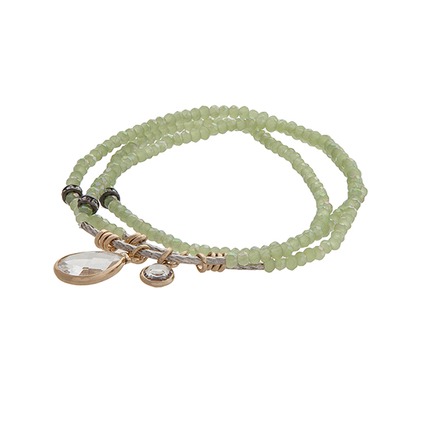 Three strand green beaded stretch bracelet with a round and teardrop shape clear cabochon.