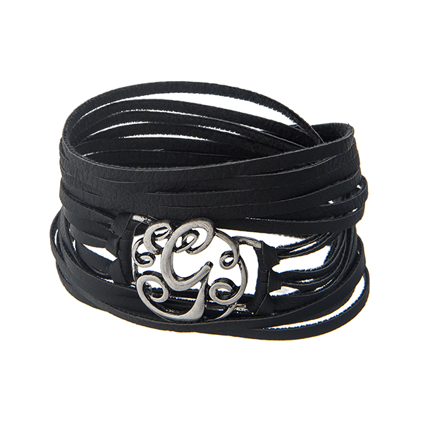 Black faux leather wrap bracelet displaying a silver tone letter 'G' and a snap closure.