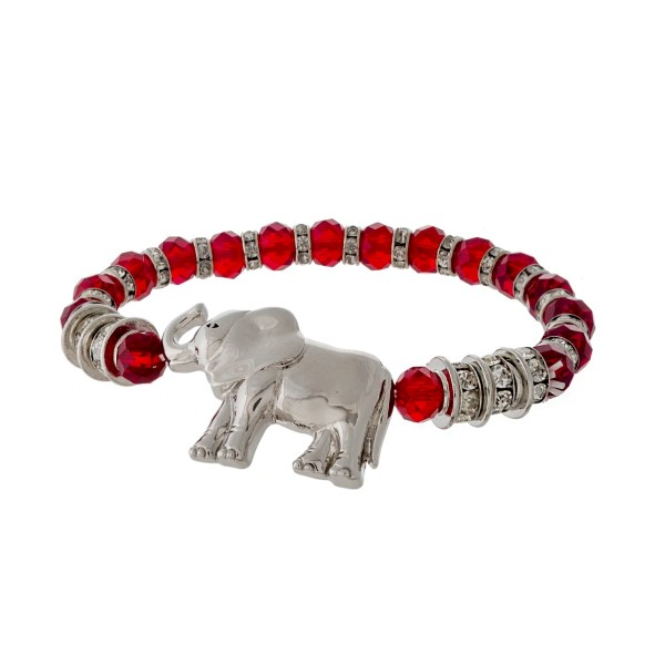 Silver tone stretch bracelet with crimson faceted beads and an elephant focal.