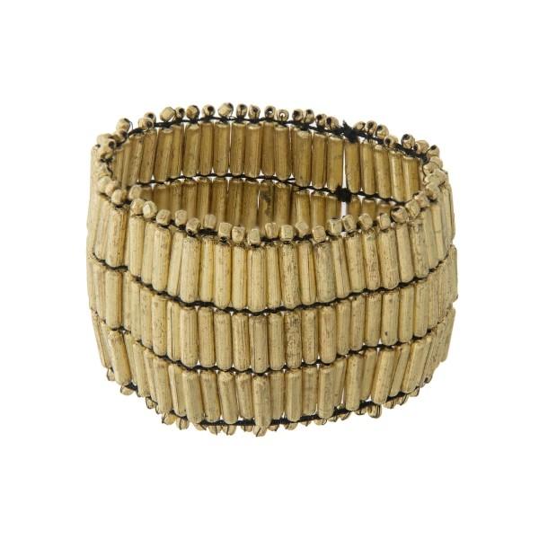 "Gold beaded stretch bracelet. Approximately 2"" wide."