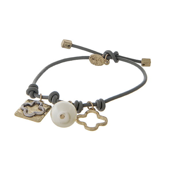 Gray leather cord adjustable bracelet with a quatrefoil charm and a pearl bead.