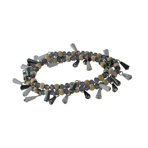 Wrap stretch bracelet with gray and navy blue beads and gold tone hardware.