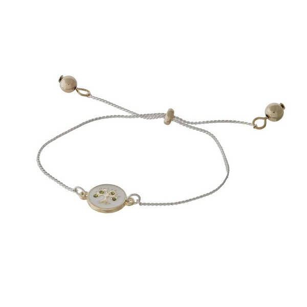 """Dainty, two tone adjustable bracelet with an epoxy tree and """"Blessed"""" engraved on the back."""