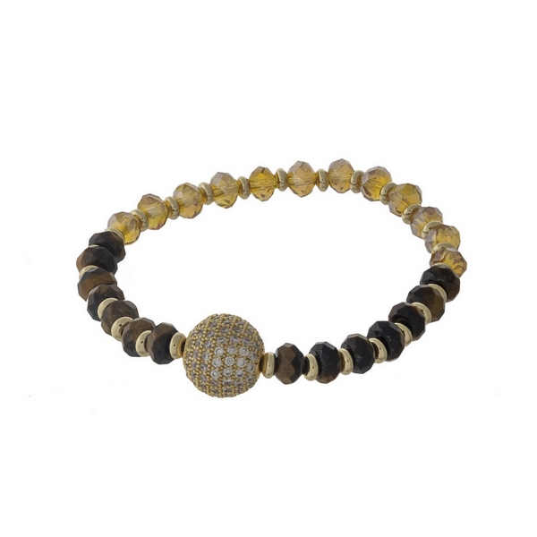 Tiger's eye and topaz beaded stretch bracelet with a gold tone pave ball focal.