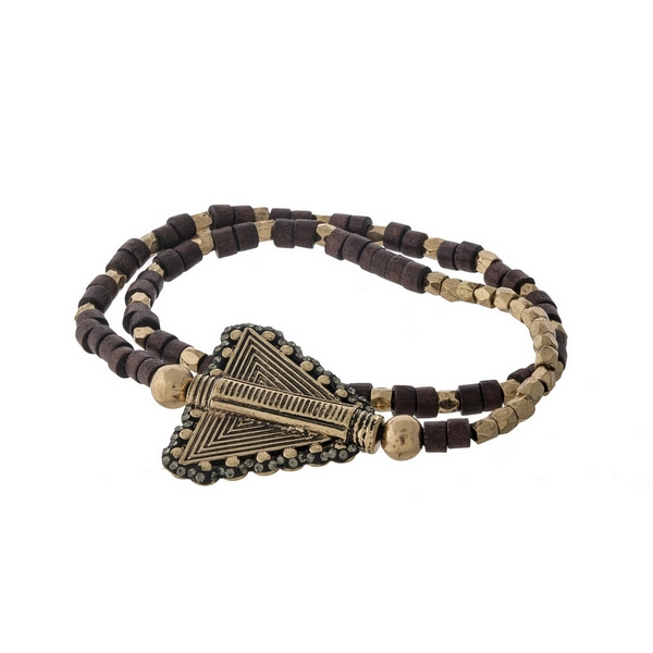 Dark brown wooden and gold tone beaded stretch bracelet with an arrow focal.