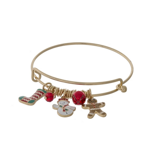 Gold tone adjustable charm bracelet with Christmas themed charms.