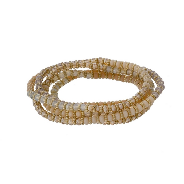 Ivory, topaz and champagne beaded stretch wrap bracelet with gold tone accents.