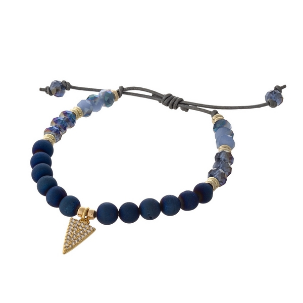 Brown waxed cord adjustable bracelet with blue natural stone beads and a triangle charm. Handmade in the USA.