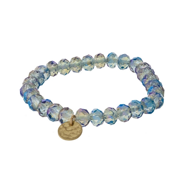 Iridescent blue faceted bead stretch bracelet with a hammered gold tone circle charm.