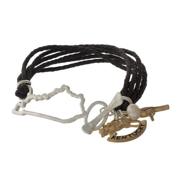 Brown braided cord bracelet with a silver tone shape of Kentucky focal, gold tone charms, and a toggle closure.