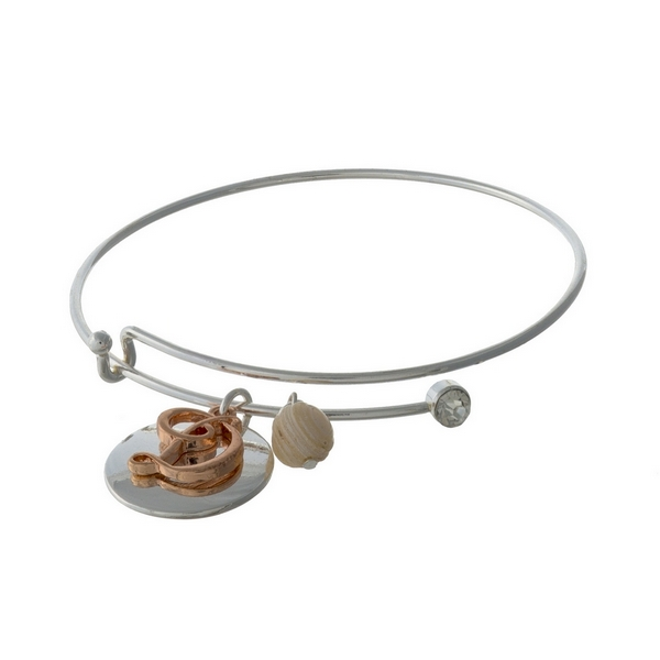 Silver tone adjustable bangle bracelet with a rose gold tone 'D' initial.