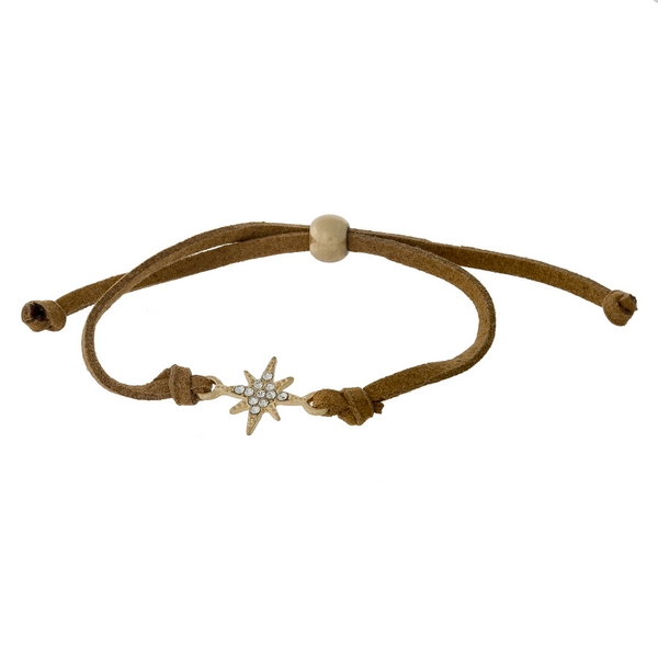 Brown faux suede, pull-tie bracelet with a gold tone star shaped focal.