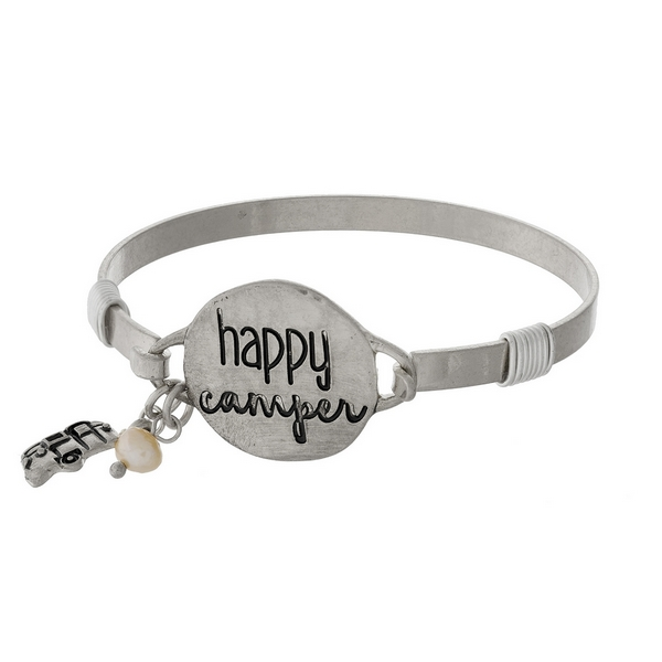 """Silver tone bangle bracelet featuring a disc stamped with """"Happy Camper"""" and accented with a freshwater pearl bead."""