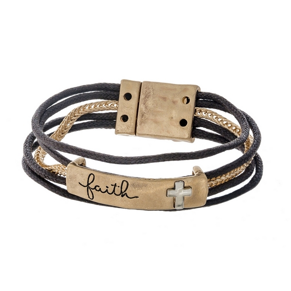 "Gold tone and brown cord bracelet featuring a bar stamped with ""Faith"" and a magnetic closure."