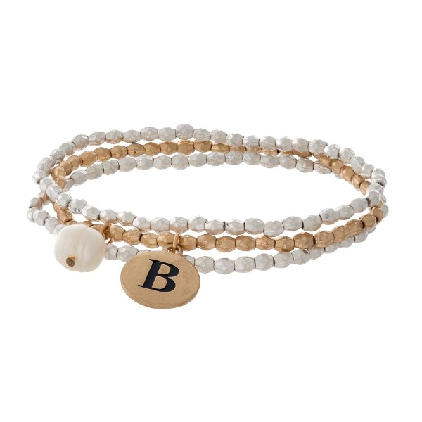 Two tone stretch bracelet with a block 'B' initial and freshwater pearl bead charm.