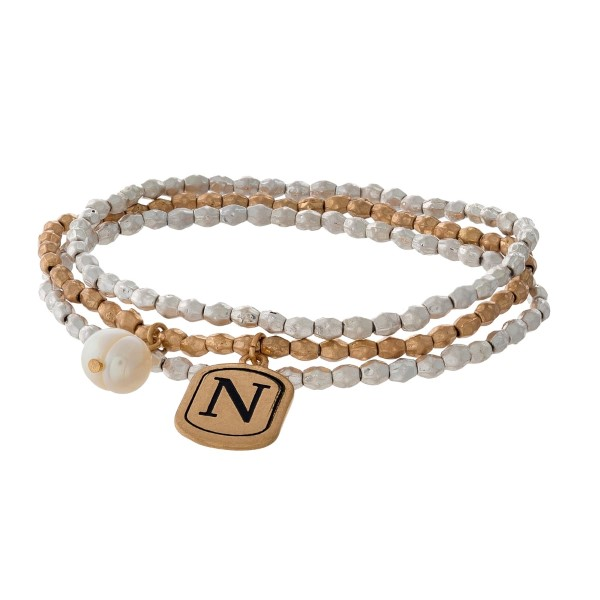 Two tone stretch bracelet with a block 'N' initial and freshwater pearl bead charm.