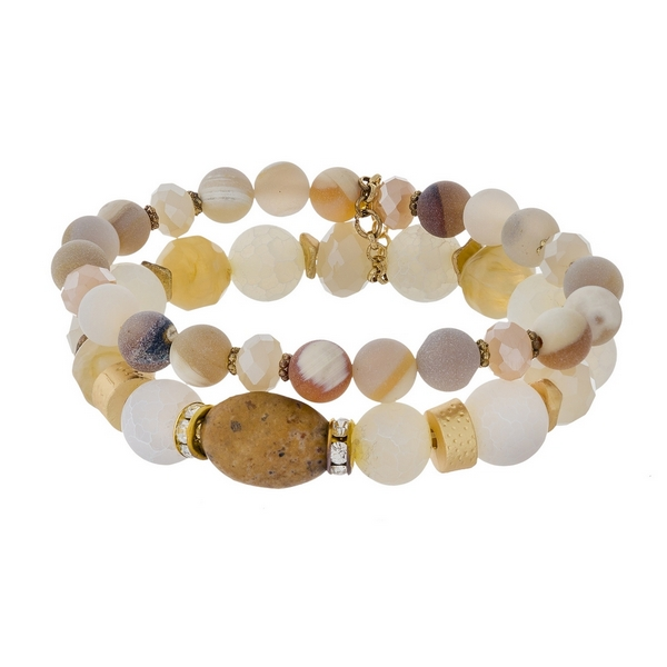 Two piece, white neutral, and gold tone natural stone beaded stretch bracelet set.