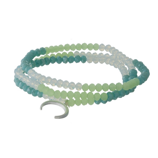 Mint green, turquoise and opal, beaded three piece stretch bracelet set featuring a silver tone horn charm.
