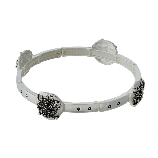 Silver tone stretch bracelet featuring sand dollar charms.