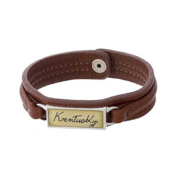 "Officially licensed, University of Kentucky brown faux leather snap bracelet with a silver tone bar saying ""Kentucky."""