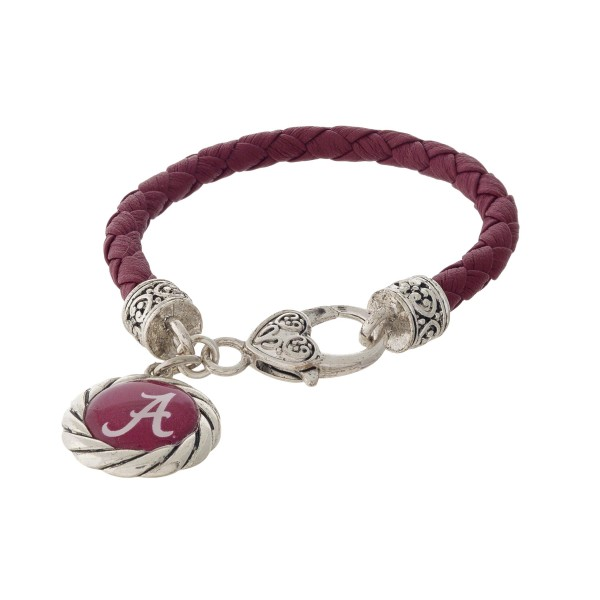 Officially licensed, University of Alabama faux leather bracelet with a silver tone clasp and a logo charm.