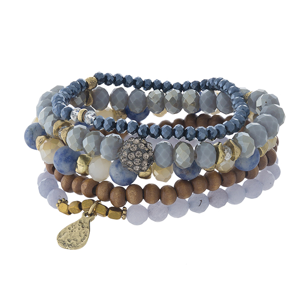 Blue and sodalite, natural stone beaded stretch bracelet set with gold tone accents.