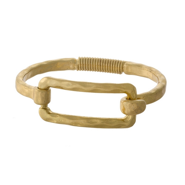 Gold tone bangle bracelet with a spring hinge and an open rectangle shape.