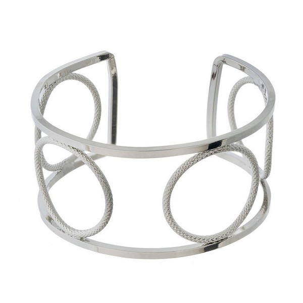 "Metal cuff bracelet with circle cutouts. Approximately 1"" in width."