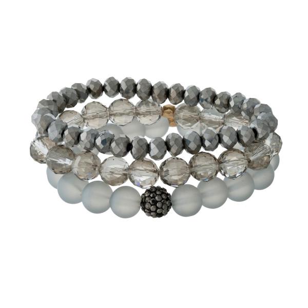Three piece stretch bracelet set with gray beads.