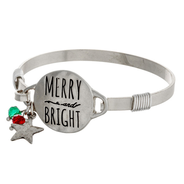 """Merry and Bright engraved silver Christmas bangle charm bracelet with wire wrapped details and hook closure. Approximately 2.5"""" in diameter. Fits up to a 5"""" wrist."""