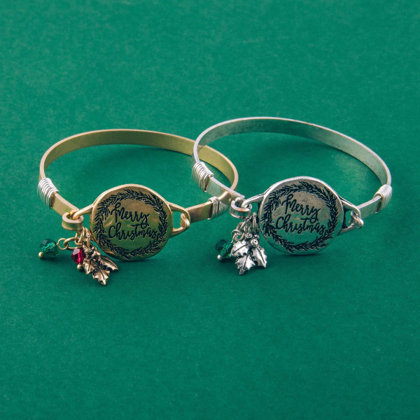 """Merry Christmas engraved gold Christmas bangle charm bracelet with wire wrapped details and hook closure. Approximately 2.5"""" in diameter. Fits up to a 5"""" wrist."""