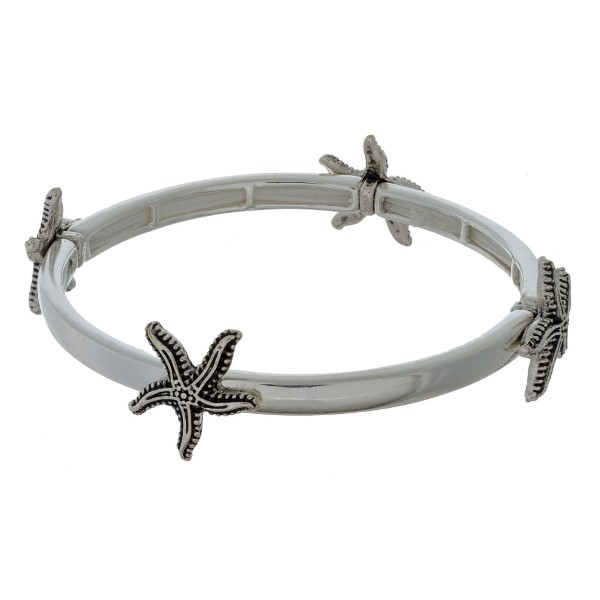 Silver tone stretch bracelet with sea life stationaries.