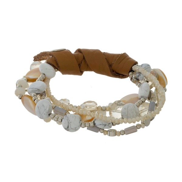 Glass and natural stone beaded stretch bracelet set with genuine leather wrapping.