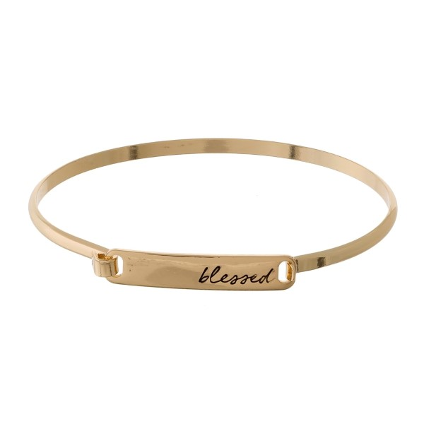 "Dainty metal bangle bracelet with a bar focal, stamped with ""blessed."""