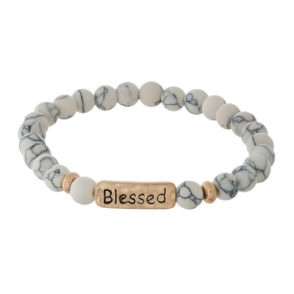 "Natural stone stretch bracelet with a bar focal, stamped with ""Blessed."""