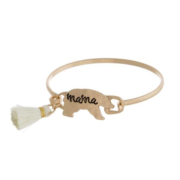 "Burnished metal, bangle bracelet with a ""Mama Bear"" stamped focal."